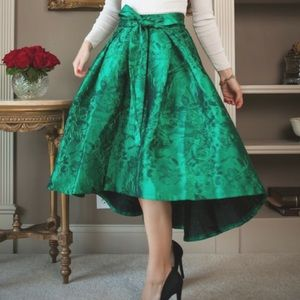 Emerald green Jacquard skirt with bow.